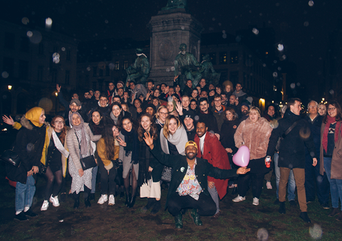 A group of young people gathered at Place du Luxembourg in Brussels.